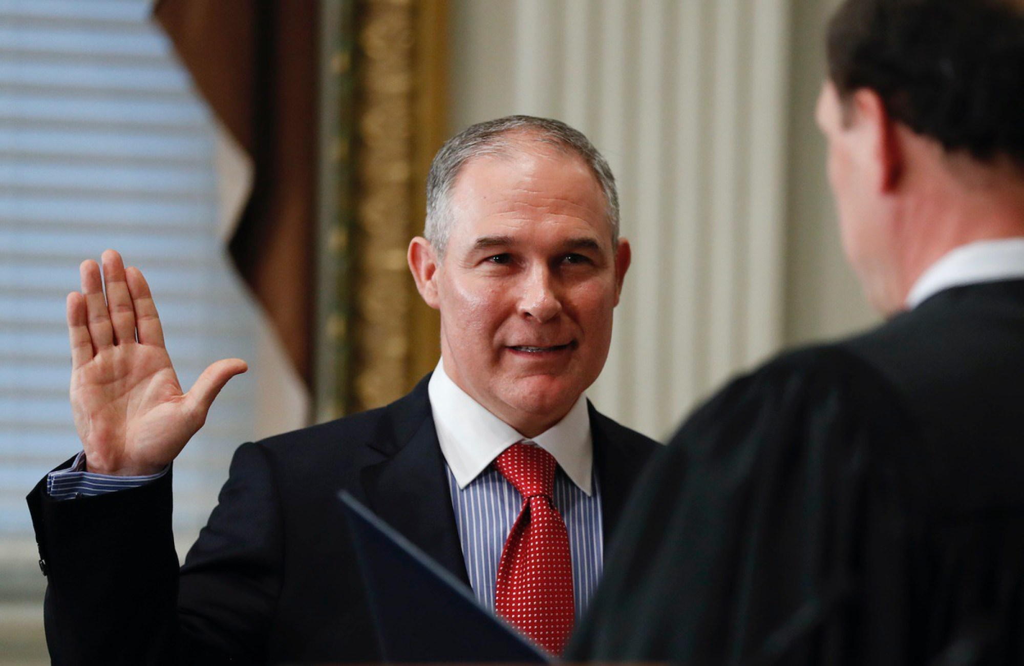 Supreme Court associate justice Samuel Alito, right, swears in Scott Pruitt as the Environmental Protection Agency Administrator in the Eisenhower Executive Office Building in the White House complex in Washington, Friday, Feb. 17, 2017. (AP Photo/Carolyn Kaster)
