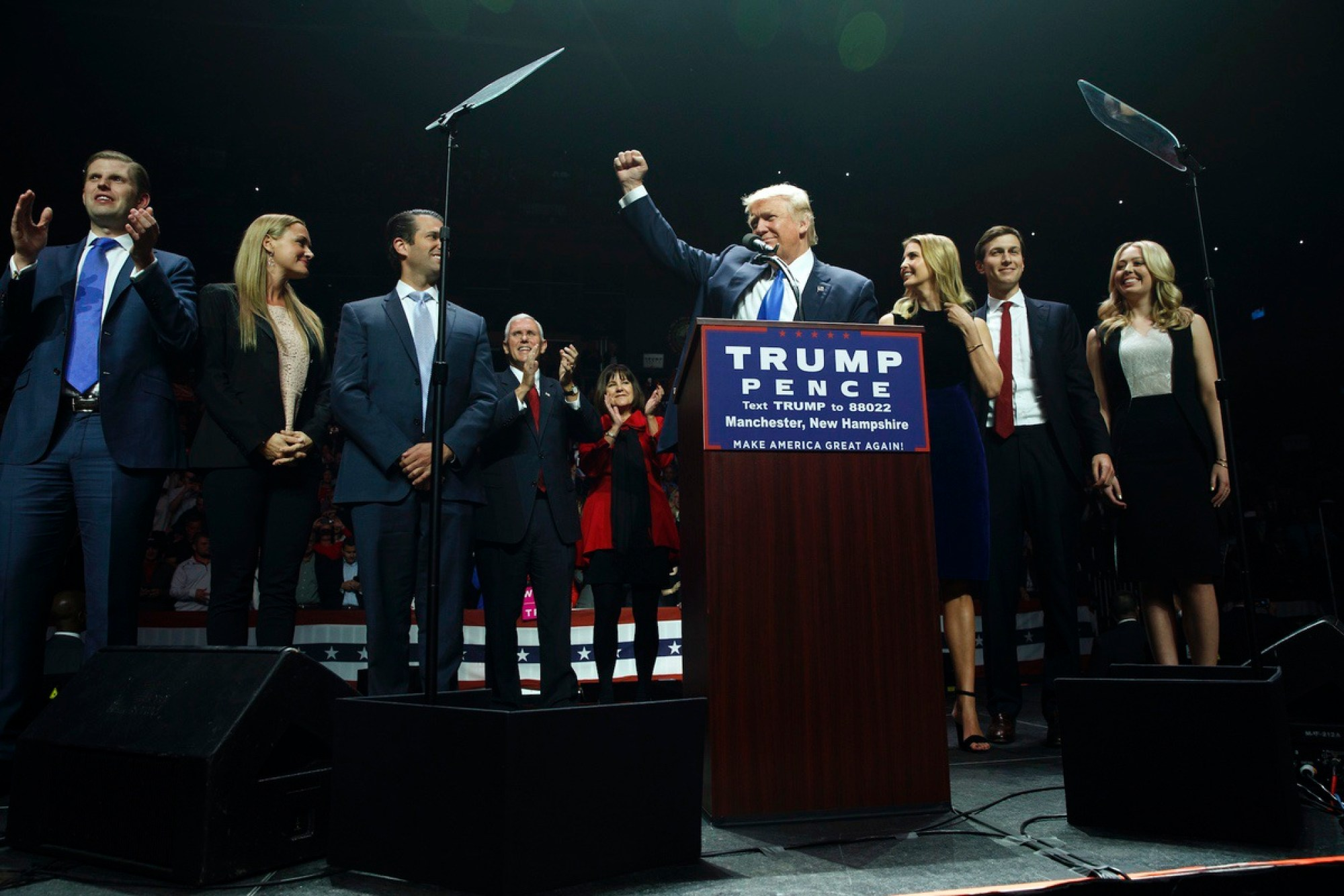 Republican presidential candidate Donald Trump pumps his fist as he arrives to speak during a campaign rally, Monday, Nov. 7, 2016, in Manchester, N.H. From left, Eric Trump, Vanessa Trump, Donald Trump Jr., Republican vice presidential candidate Gov. Mike Pence, R-Ind., Karen Pence, Trump, Ivanka Trump, Jared Kushner, and Tiffany Trump. (AP Photo/ Evan Vucci)