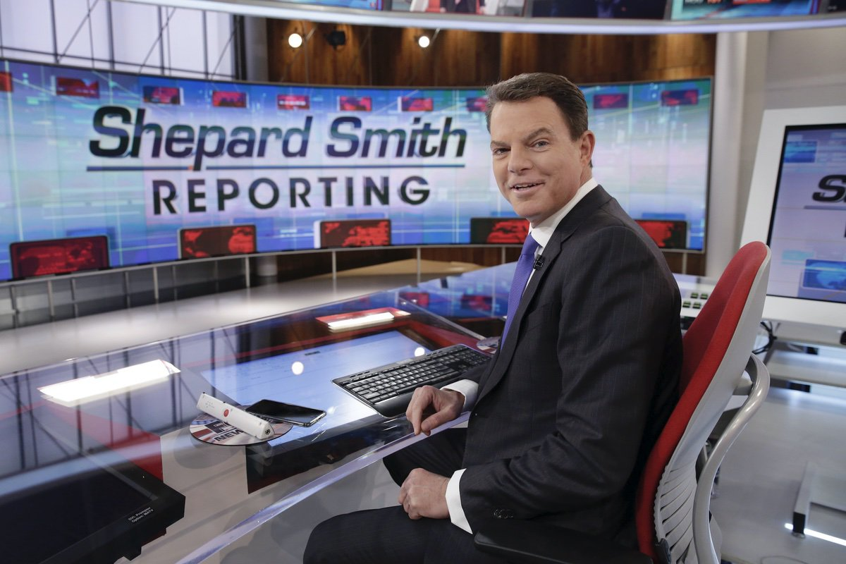 """Fox News Channel chief news anchor Shepard Smith appears on The Fox News Deck before his """"Shepard Smith Reporting"""" program, in New York. Jan. 30, 2017 (AP Photo/Richard Drew, File)"""