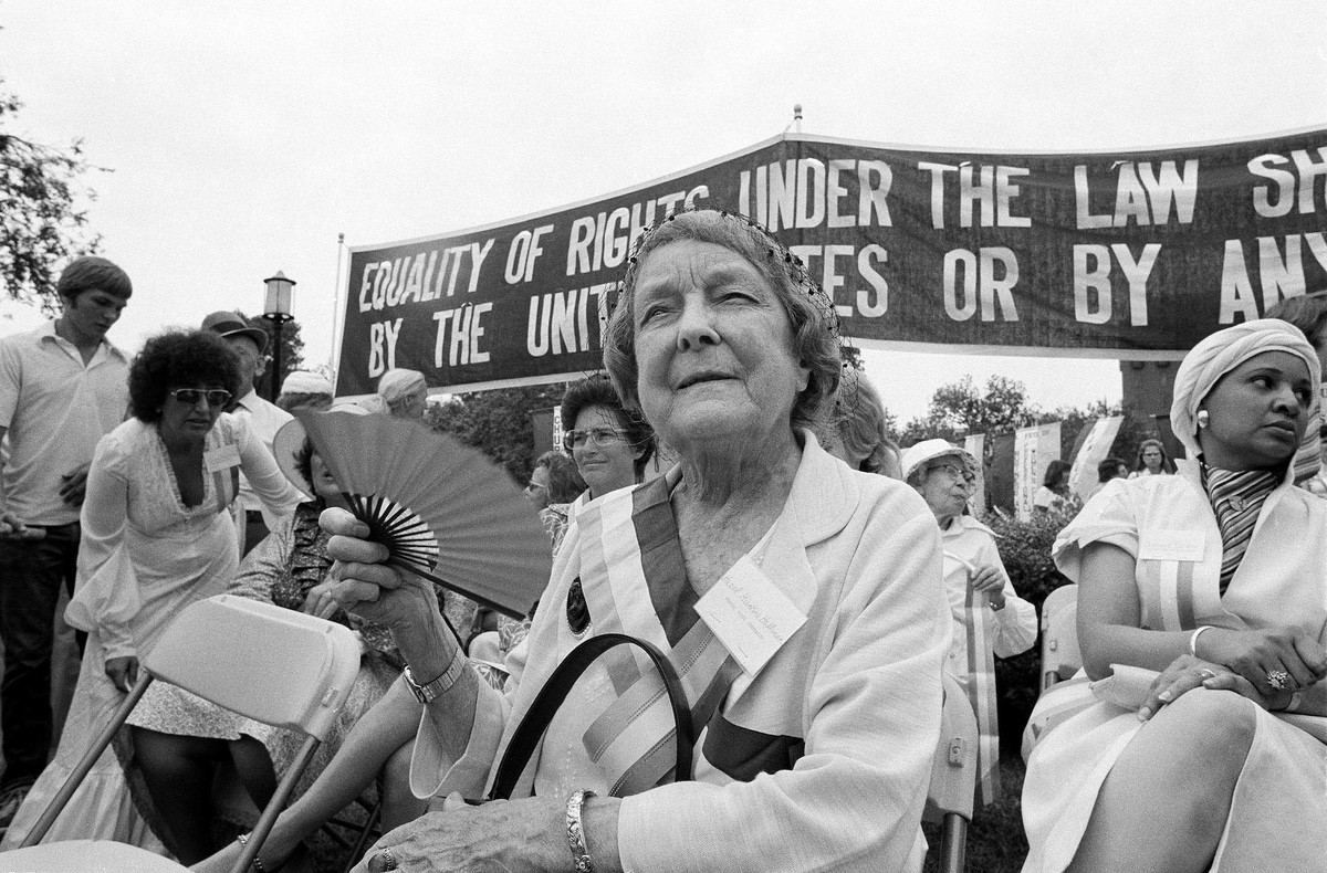 Hazel Hunkines Hallinnan, one of the original suffragists, rests after marching with supporters of the Equal Rights Amendment on Washington's Pennsylvania Avenue. Thousands of women participated in the march which coincided with the 57th anniversary of women's suffrage – August 26, 1977 (AP File Photo)
