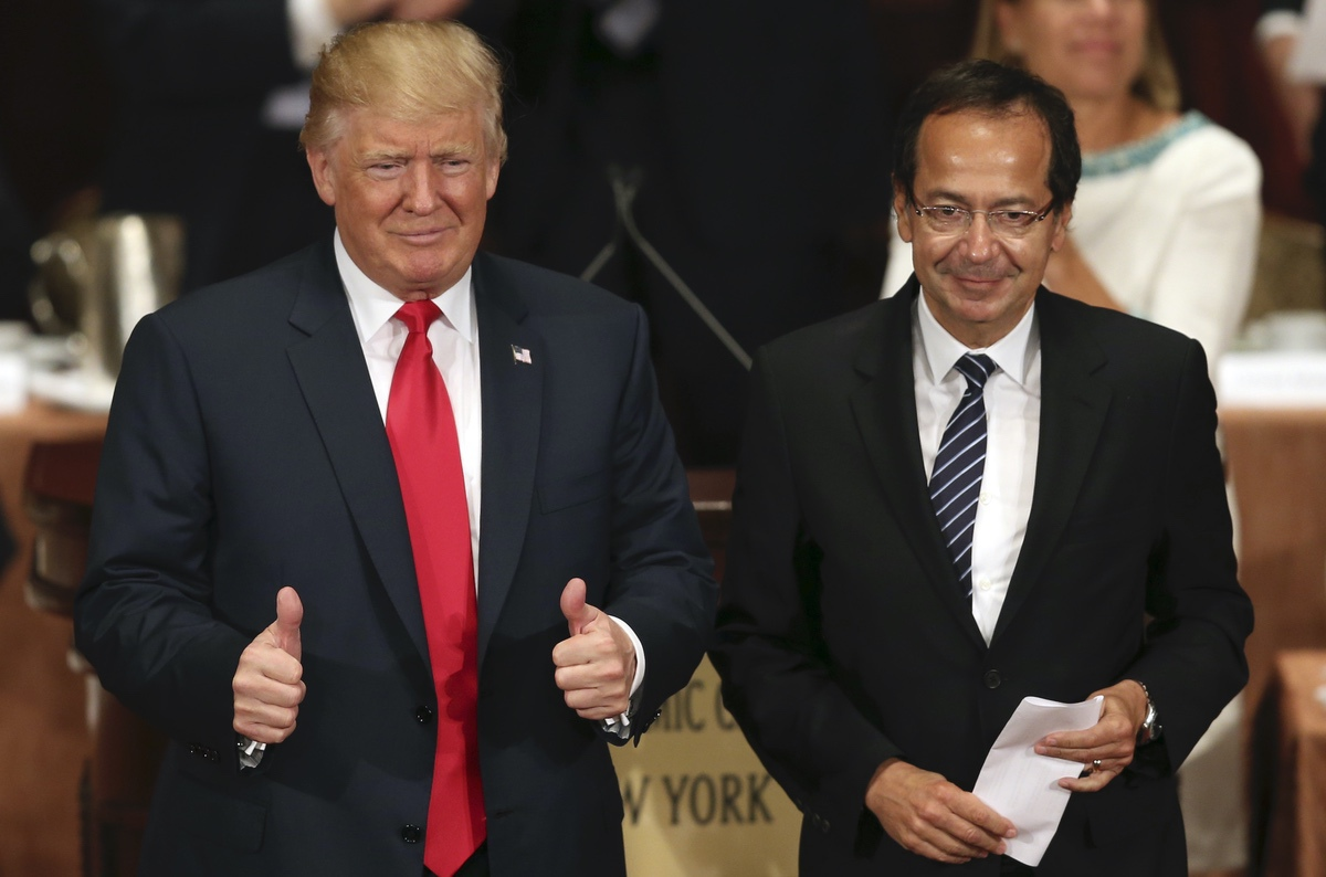 Then-Republican presidential candidate Donald Trump gives the thumbs up while standing with John Paulson at a luncheon for the Economic Club of New York in New York, Thursday, Sept. 15, 2016. (AP Photo/Seth Wenig)