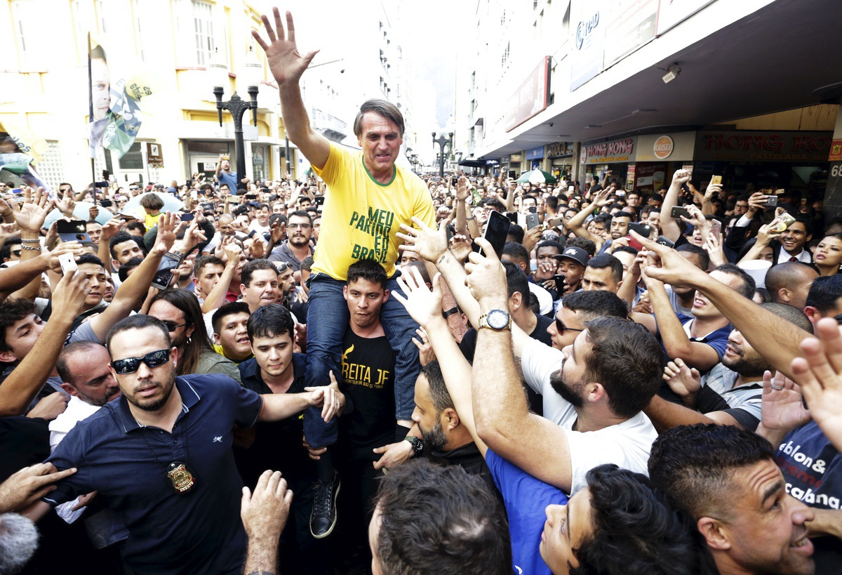 Presidential candidate Jair Bolsonaro is taken on the shoulders of a supporter moments before being stabbed during a campaign rally in Juiz de Fora, Brazil, Thursday, Sept. 6, 2018. He survived. (Antonio Scorza/Agencia O Globo via AP)