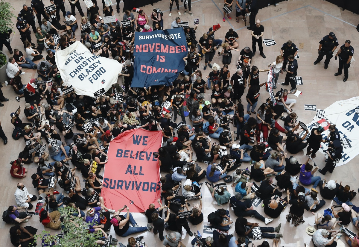 Protesters gather in the atrium of the Hart Senate Office Building on Capitol Hill ahead of the vote to confirm Brett Kavanaugh, Thursday, Oct. 4, 2018 in Washington. (AP Photo/Alex Brandon)
