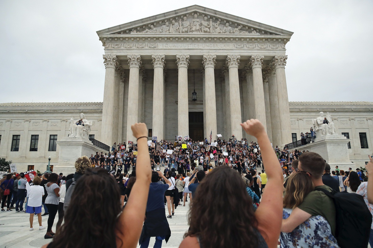 Activists protest on the steps and plaza of the Supreme Court after the confirmation vote of Supreme Court nominee Brett Kavanaugh, on Capitol Hill, Saturday, Oct. 6, 2018 in Washington. (AP Photo/Alex Brandon)