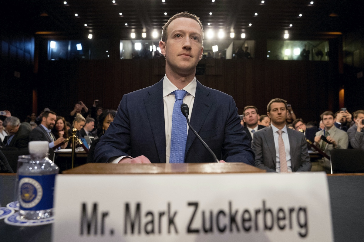 Facebook CEO Mark Zuckerberg arrives before a joint hearing of the Commerce and Judiciary Committees on Capitol Hill in Washington, Tuesday, April 10, 2018. (AP Photo/Andrew Harnik)