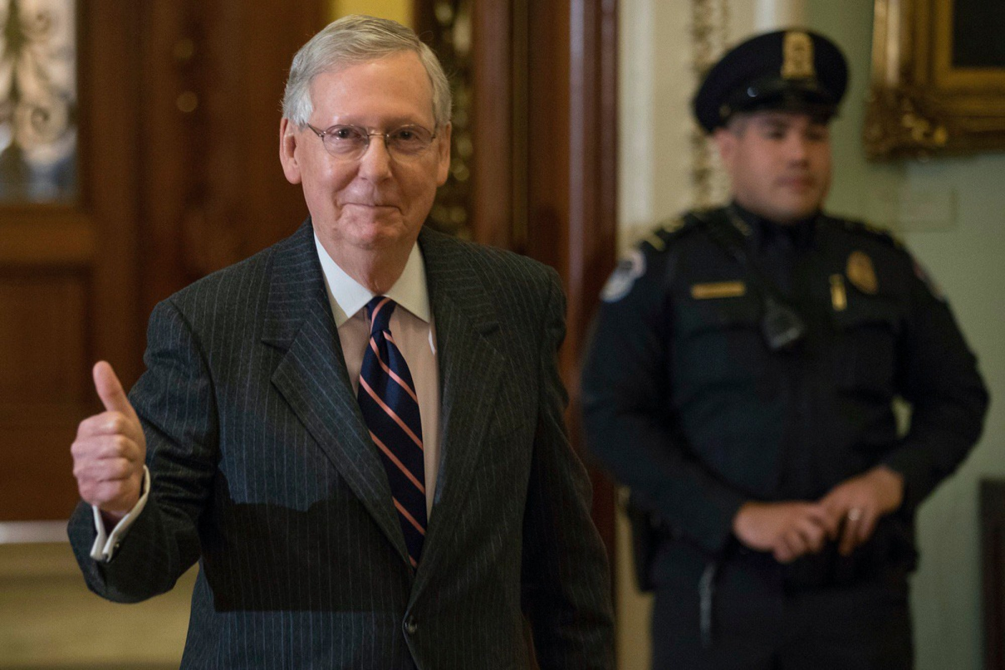 Senate Majority Leader Mitch McConnell of Ky. gives members of the media a thumbs up as he leaves the Senate chamber on Capitol Hill, in Washington, Tuesday, Feb. 7, 2017. (AP Photo/Andrew Harnik)