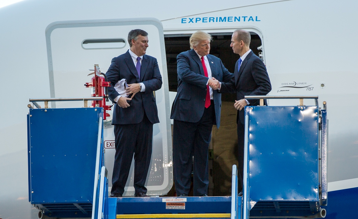 President Donald Trump shaking Boeing CEO Dennis Muilenburg's hand at the ceremony for the rollout of the Boeing's first 787-10 in South Carolina in North Charleston, SC – On February 17, 2017. (Wikimedia/Ryan Johnson)