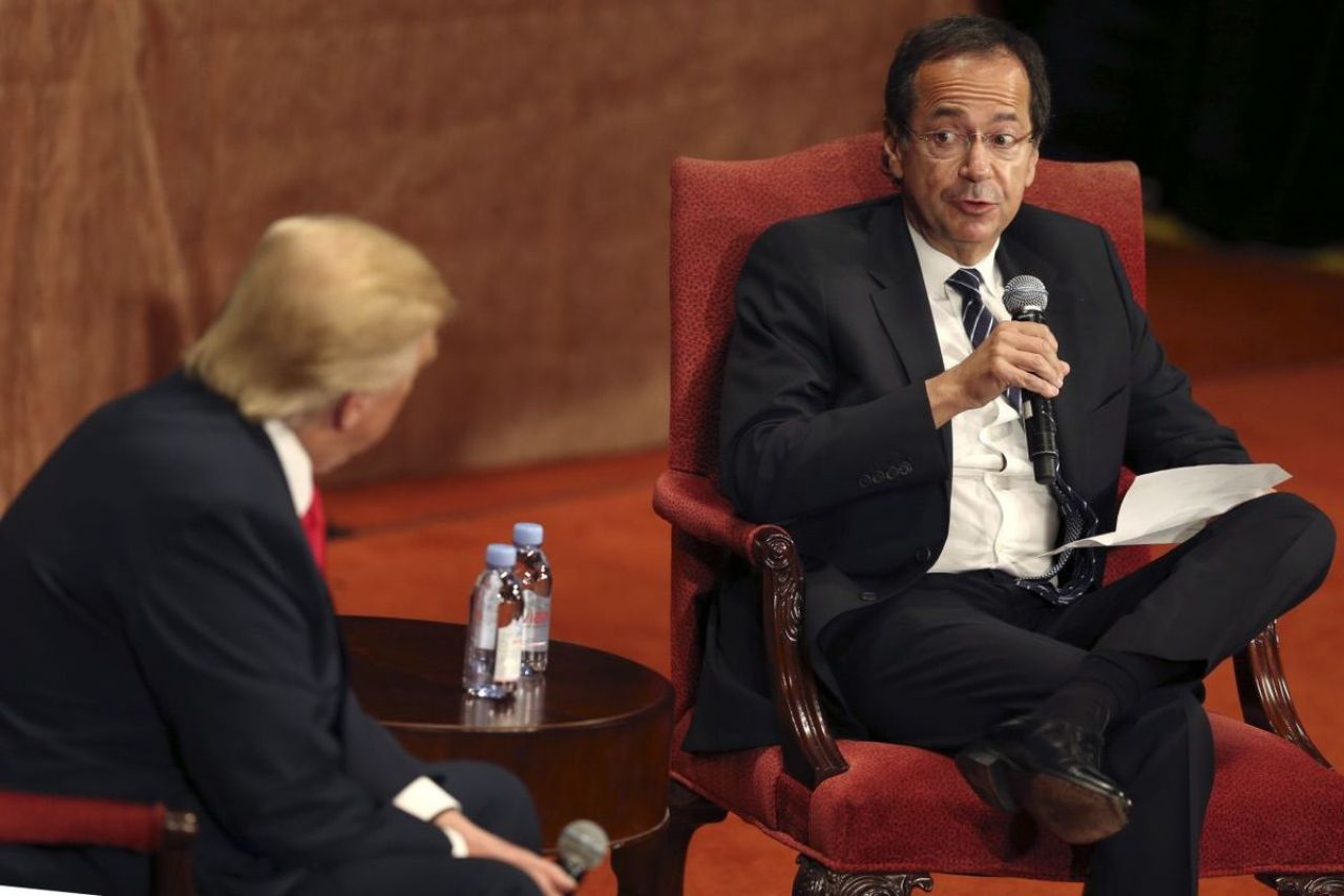 Investor John Paulson, whose firm made $20 billion from the 2008 financial crisis, asking then-candidate Donald Trump questions at the Economic Club of New York luncheon in September 2016. (Seth Wenig/AP)