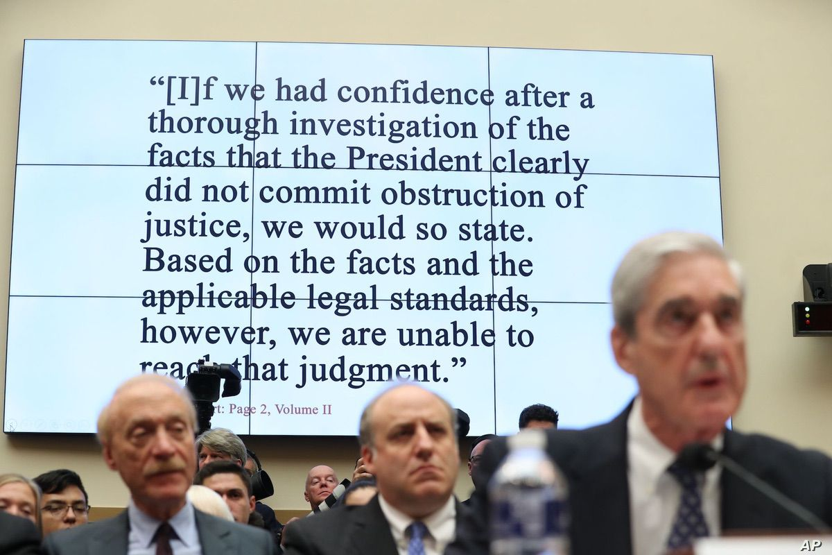 Former special counsel Robert Mueller testifies before the House Judiciary Committee hearing on his report on Russian election interference, on Capitol Hill, in Washington, Wednesday, July 24, 2019. A line from Mueller's report is shown on the rear screen during the hearing. (AP Photo/Andrew Harnik)