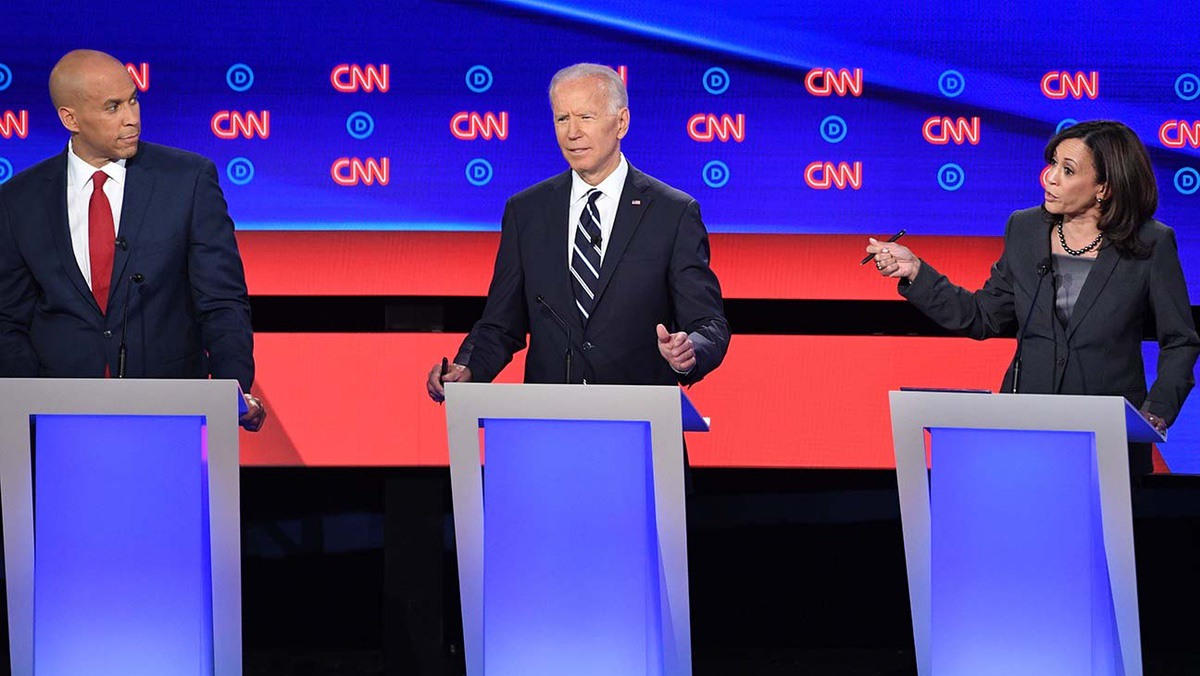 Democratic presidential hopefuls (fromL) US Senator from New Jersey Cory Booker looks on as former Vice President Joe Biden gestures next to US Senator from California Kamala Harris during the second round of the second Democratic primary debate of the 2020 presidential campaign season hosted by CNN at the Fox Theatre in Detroit, Michigan on July 31, 2019. (Photo by Jim WATSON / AFP) (Photo credit should read JIM WATSON/AFP/Getty Images)
