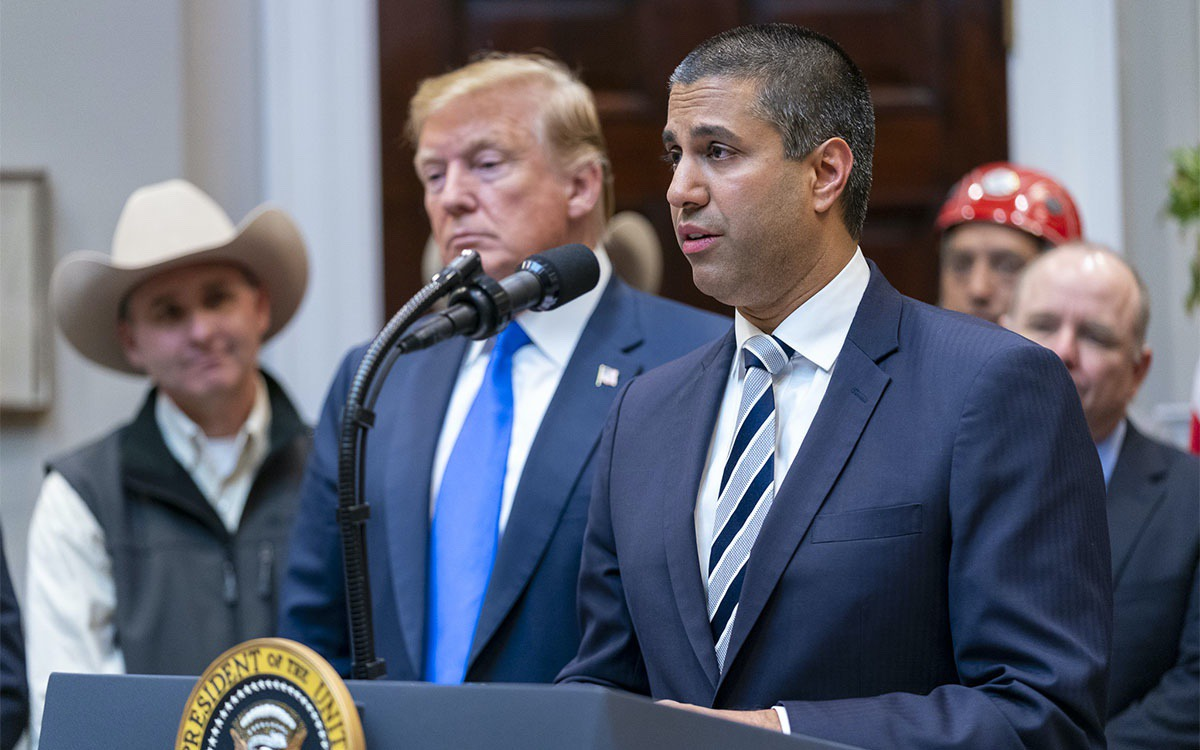 President Donald J. Trump listens as Chairman Ajit Pai of the Federal Communications Commission delivers remarks on U.S. 5G deployment technology Friday, April 12, 2019, in the Roosevelt Room at the White House. (Official White House Photo by Shealah Craighead)
