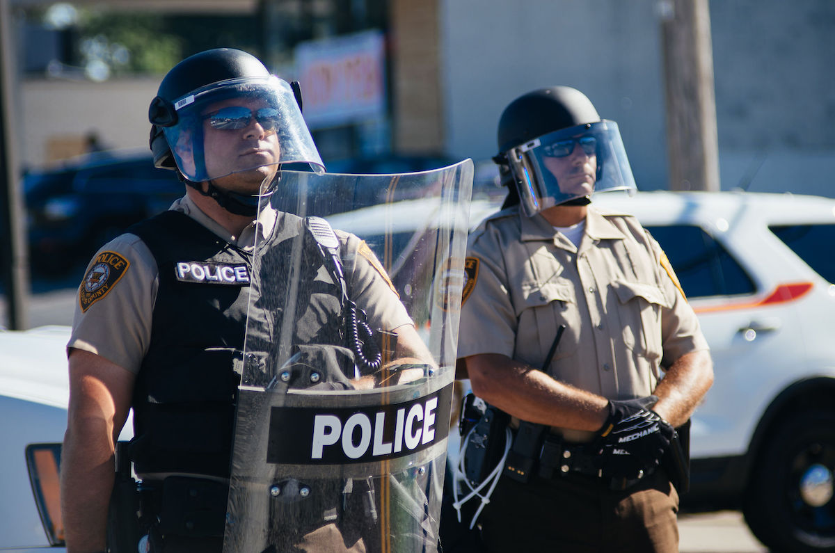 Police in riot gear at Ferguson protests – August 13, 2014 (Jamelle Bouie/Creative Commons)
