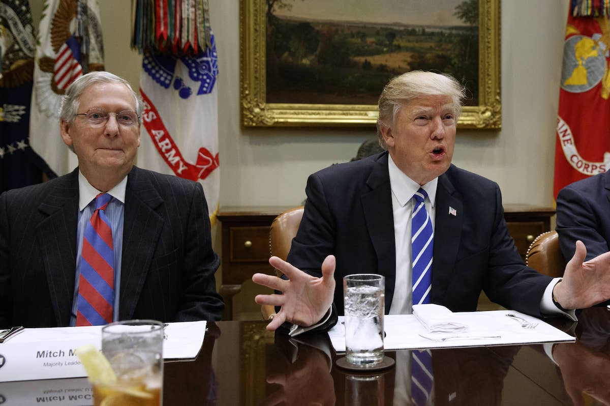 Senate Majority Leader Mitch McConnell (R-KY) listens as President Donald Trump speaks during a meeting with House and Senate leadership in the Roosevelt Room of the White House, Wednesday, March 1, 2017, in Washington. (AP Photo/Evan Vucci)