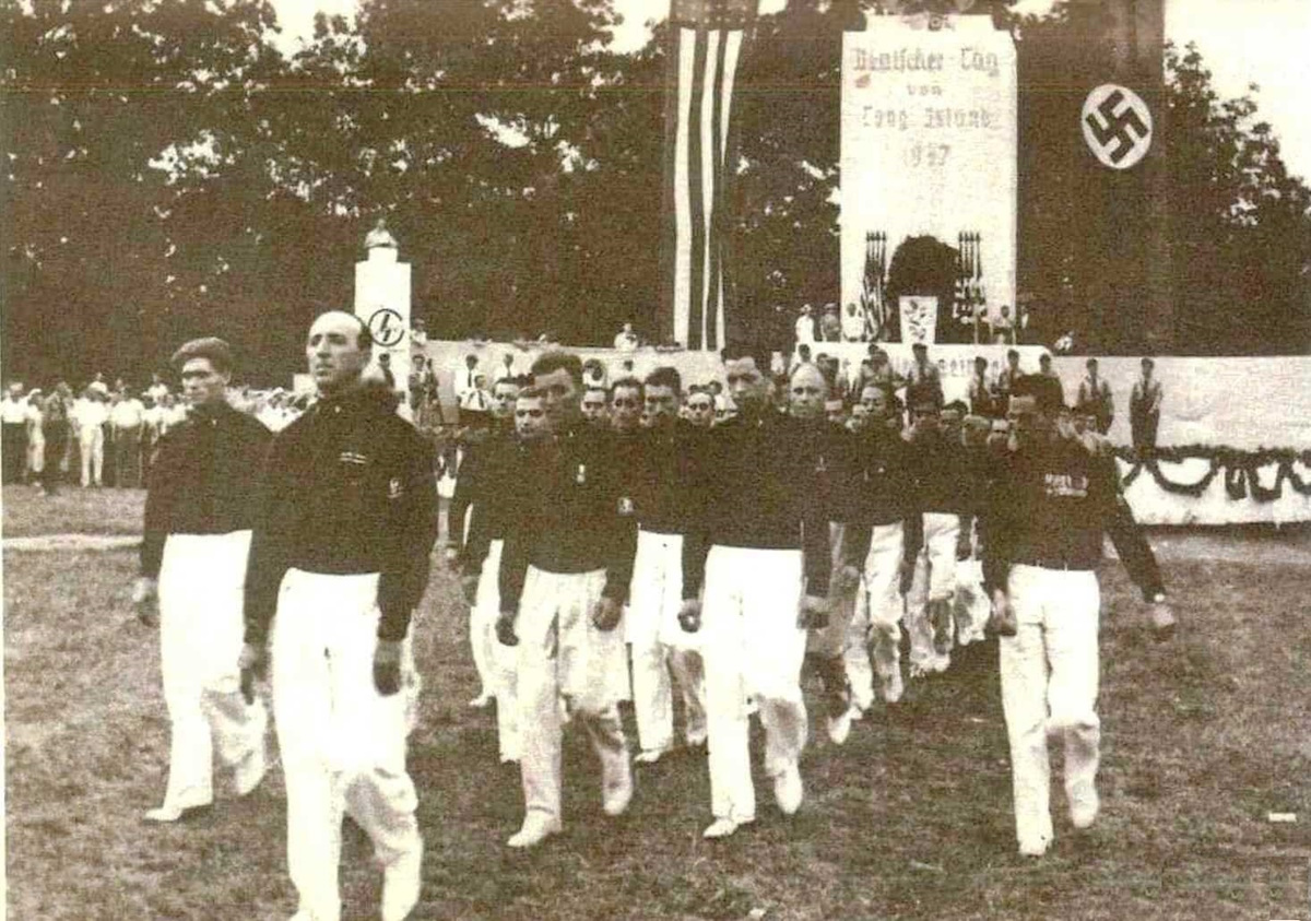 Blackshirts marching at Camp Siegfried, in Yaphank, New York, on Long Island, in the 1930s. The holiday camp was owned by the German American Bund, an American Nazi group, and was run by the German American Settlement League. It featured the ideology and symbols of Nazism and Fascism.