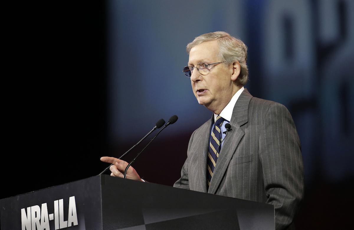 Senate Minority Leader Mitch McConnell (R-KY), speaks at the leadership forum at the National Rifle Association's annual convention Friday, April 25, 2014. (AP Photo/AJ Mast)