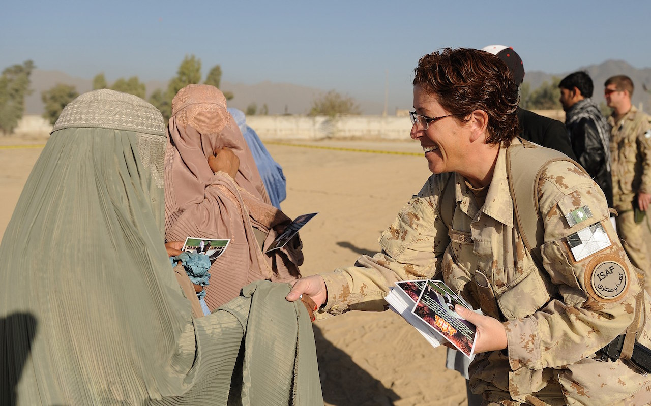 Sgt Tanya Casey, a volunteer from Camp Nathan Smith, greets an Afghan woman during the celebration of Eid al-Adha – November 21, 2009. (Photo by Master Corporal Angela Abbey, Canadian Forces Combat Camera)