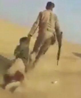 Iraq soldier dragging terrorist