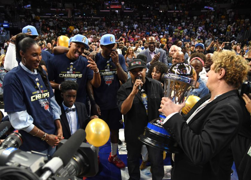 LOS ANGELES, CALIFORNIA - SEPTEMBER 01: BIG3 co-founders Ice Cube and Jeff Kwatinetz present the trophy to head coach Lisa Leslie and the Triplets after they defeated the Killer 3s to win the BIG3 Championship at Staples Center on September 01, 2019 in Los Angeles, California. (Photo by Harry How/BIG3 via Getty Images)