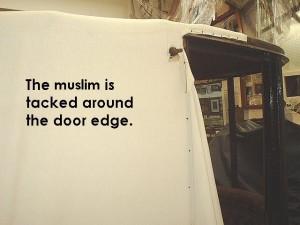 Muslim tacked around door