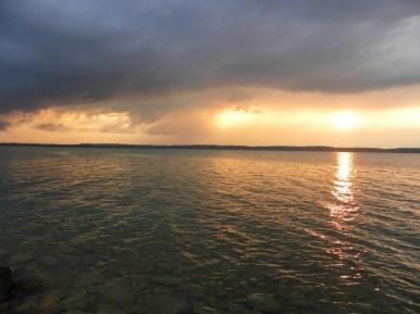 Golden gauzy light with lake rocks