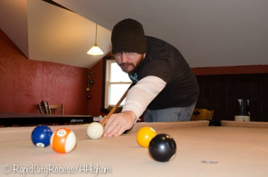 Tony playing pool at Mom and Dad's
