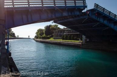 Bridge raising, lighthouse in distance