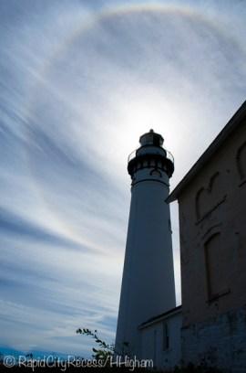 lighthouse and sun halo