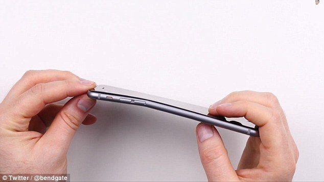 Bending iPhones in Apple stores: Kid puts the stress test on