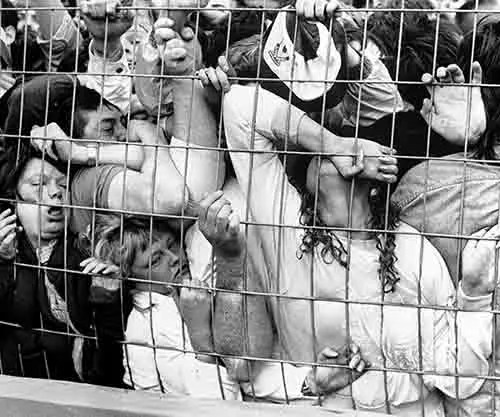 People being crushed against a fence during a human crush at Hillsborough Stadium, 1989