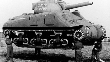 Two American Soldiers Inspect A Destroyed German King Tiger Tank 1944