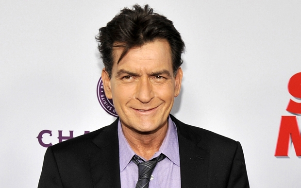 """FILE - In this April 11, 2013 file photo, Charlie Sheen, a cast member in """"Scary Movie V,"""" poses at the Los Angeles premiere of the film at the Cinerama Dome in Los Angeles. Sheen is set to """"make a revealing personal announcement"""" on NBC's """"Today"""" show on Tuesday, Nov. 17, 2015, NBC announced on Monday. (Photo by Chris Pizzello/Invision/AP, file)"""