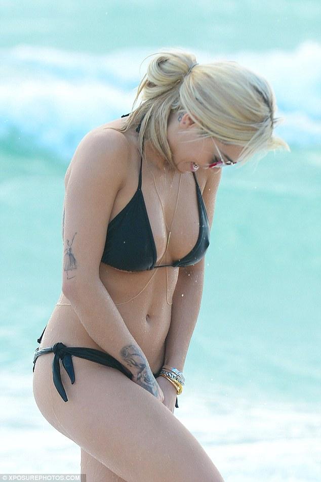 Yikes Rita Ora Suffers Wardrobe Malfunction At The Beach
