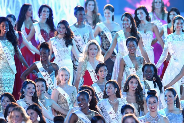 Albijona Muharremaj (C) Miss World Germany attends the Miss World Grand Final in Sanya, in southern China's Hainan province on December 19, 2015. Contestants from over 110 countries compete in the final of the 65th Miss World Competition. AFP PHOTO / JOHANNES EISELE / AFP / JOHANNES EISELE        (Photo credit should read JOHANNES EISELE/AFP/Getty Images)
