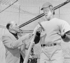 """09 Mar 1965, Hollywood, Los Angeles, California, USA --- With spring training in full swing, where is Leo Durocher, erstwhile lippy former manager and coach of the Dodgers? He's out trying to make a ballplayer out of Herman Munster of CBS TV's . In the segment , Leo discovers Herman as a """"rookie of the year"""". Durocher was vociferous in his praise of Fred Gwynne, who plays the abominable Herman Munster. --- Image by © Bettmann/CORBIS"""