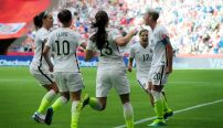 June 16, 2015: United States forward Abby Wambach (20) is congratulated by teammates on a late first half goal that propelled the team past Nigeria on Tuesday at BC Place in Vancouver, British Columbia. They are midfielder Carli Lloyd (10), forward Alex Morgan (13) and midfielder Tobin Heath (17). (Icon