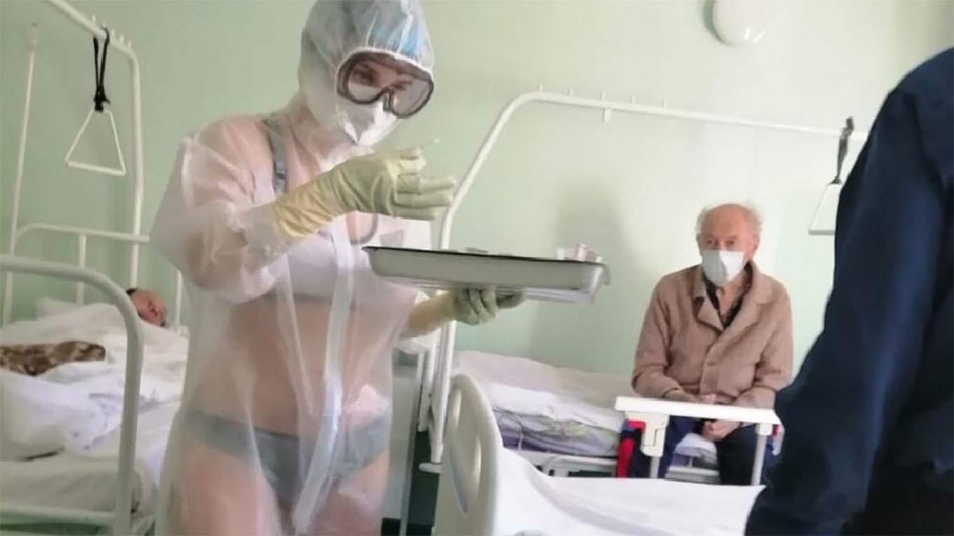 Russian nurse disciplined for showing bikini outfit under see-through PPE in male-only Covid-19 ward