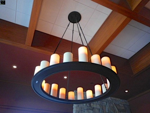 small/11384.jpg CHANDELIER APPROX 40 ROUND, BLACK BASE WITH CANDLE ACCENTS, MOUNTED 15FT IN AIR