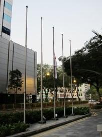 Flags fly half mast outside the Treasury.