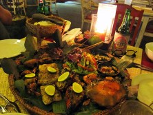 Seafood platter and beer.. Look at the impressive spread! Crab, prawns, snapper, squid, lobster, chicken satay and ribs!