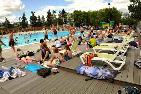 people at outdoor swimming pool