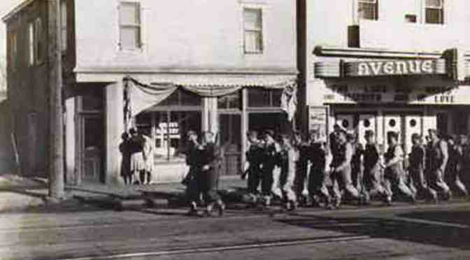 "<span class=""entry-title-primary"">Tales of a wartime photo: what happened here</span> <span class=""entry-subtitle"">Men walk down Alberta Avenue supporting of the war effort</span>"