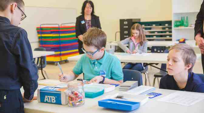"""<span class=""""entry-title-primary"""">Students learn financial literacy with program</span> <span class=""""entry-subtitle"""">Junior ATB gives students an opportunity to run a bank</span>"""