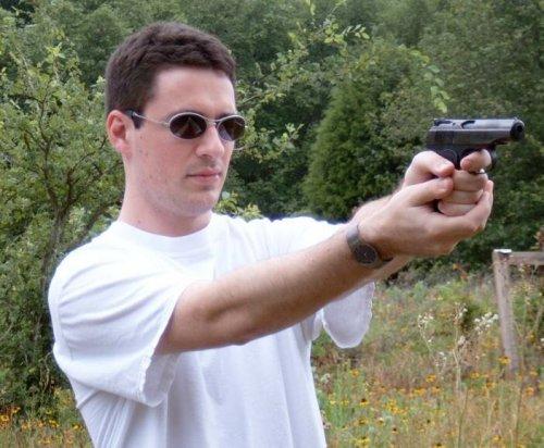 David firing a gun