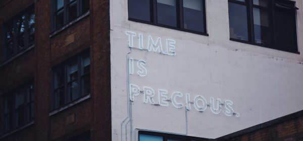 A building showing Time is Precious