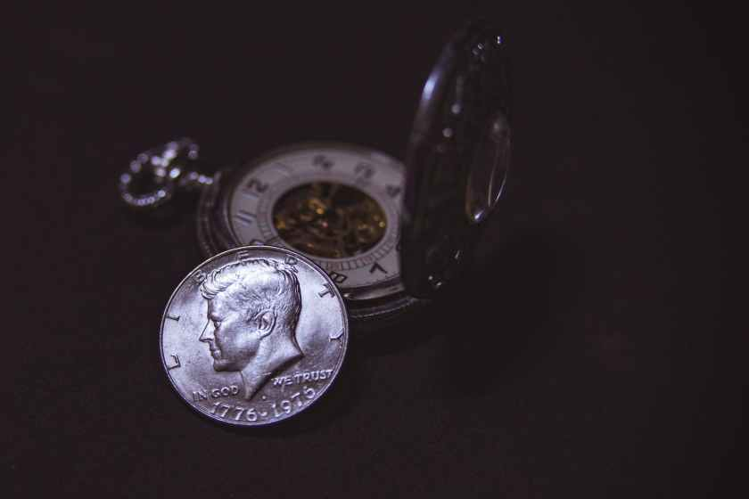 round silver colored liberty coin