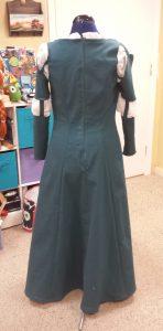 The zipper sew into the dress