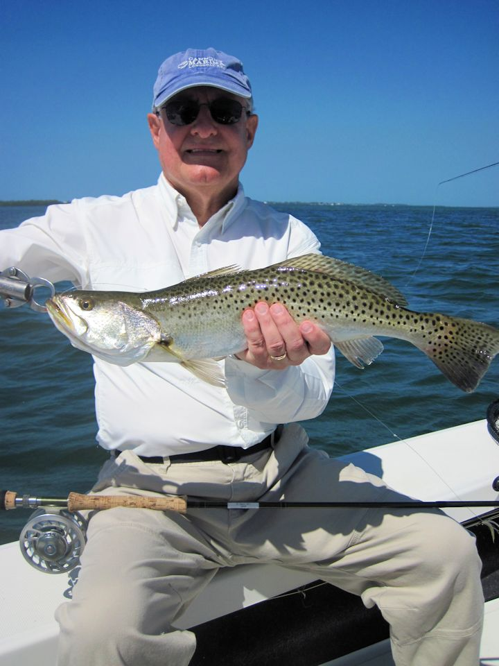 There should be good action on deep grass flats during March. Alan Sugar, from MI, caught and released this nice trout on an Ultra Hair Clouser fly while fishing Sarasota Bay with Capt. Rick Grassett in a previous March.
