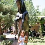 Kayla under horse statue in Tlaquepaque