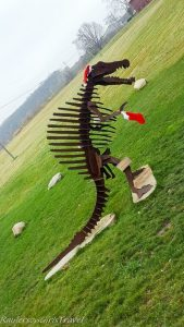 Metal Tyrannosaurus Rex statue decorated for the holidays at Dinosaur Farm in Coloma, Michigan