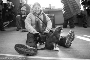 Heather Raulerson playing with puppies at Chena Dog Kennel